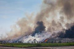 Burning garbage heap of smoke Royalty Free Stock Images