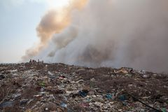 Burning garbage heap of smoke Royalty Free Stock Image