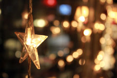 Burning garland in the form of a star Stock Images