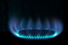 Burning gas. In a gas burner on a black background royalty free stock image