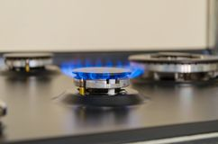 Burning gas burner. Blue fire with a red flame stock images