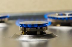 Burning gas burner. Blue fire with a red flame Royalty Free Stock Images