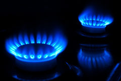Burning gas burners Stock Images