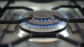 Burning gas in cooker hobs stock footage