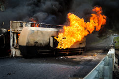 Burning gas flame tank truck road accident Royalty Free Stock Photos
