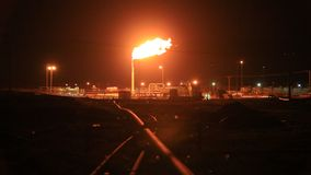 Burning gas flare in the desert stock video footage