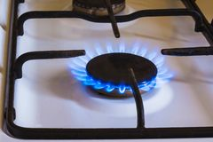 Burning gas, gas stove burner, hob in kitchen. Burning gas, gas stove burner, hob in the kitchen stock photos