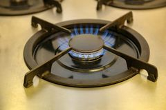 Burning gas, gas stove burner, hob in the kitchen.  stock photos