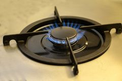 Burning gas, gas stove burner, hob in the kitchen.  royalty free stock image