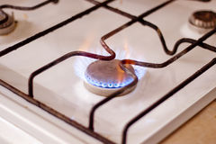 Burning gas on kitchen gas stove. Macro Stock Photos