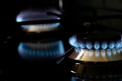 Burning gas stove blue flames close up in the dark on a black background. Image royalty free stock images