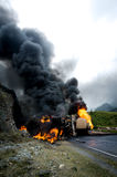 Burning gas tank truck road accident Royalty Free Stock Images