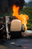 Burning gas tank truck road accident Stock Photos