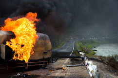 Burning gas tank truck road accident Royalty Free Stock Photography