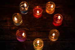 Burning gel candles in the shape of heart on wooden table Royalty Free Stock Photography