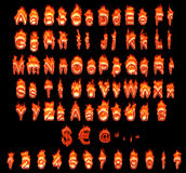 Burning German alphabet with umlauts Stock Images