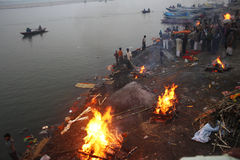 Burning Ghat. February 11,201 Benaras,Uttar Pradesh,India,Asia- Cremation flames of the burning ghats at Marnikanika Ghat Stock Images