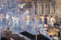 Burning ghats. The famous  Burning ghats of Varanasi. The smoke of the funeral pyres is obscuring the sight Royalty Free Stock Photos