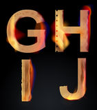 Burning GHIJ letters, burning alphabet Royalty Free Stock Image