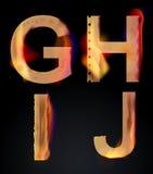 Burning GHIJ letters, burning alphabet. Burning GHIJ letters over dark,alphabet, illustration Royalty Free Stock Image