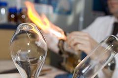 Burning glas. Glass artist making a vase Stock Photos