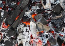 Burning and glowing charcoal with open hot flame and smoke close Royalty Free Stock Images