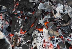 Burning and glowing charcoal with open hot flame and smoke close Stock Photos
