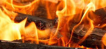 Burning and glowing charcoal with open hot flame and smoke. Close up Stock Images