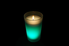 Burning green candle Stock Photos
