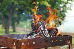Burning grill Stock Photography