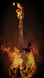 Burning guitar. Legendary guitar with flames on a dark background Stock Photo