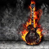 The burning guitar. In the old room Stock Photo