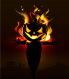 Burning Halloween scarecrow Stock Images