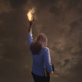 Burning hand with Bible Royalty Free Stock Images