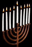Burning hanukkah candles in a menorah Royalty Free Stock Photo