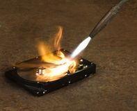 Burning a hard disk drive Stock Photography