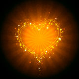 Burning heart. With sparkles on a dark background Royalty Free Stock Photo