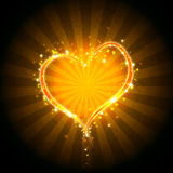 Burning heart. With sparkles on a dark background Royalty Free Stock Photography