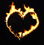 Burning heart. Over black background Stock Images