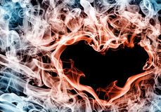 Burning heart. Smokey burning heart on black Royalty Free Stock Photo