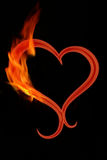Burning heart. Red lightening heart  with flames on a black  background Stock Photography