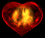 Burning Heart. A passionate burning heart isolated on black background Stock Photos