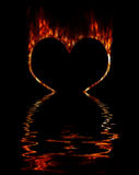Burning heart. Burning fiery contour of heart on a black background. Immersing in water Royalty Free Stock Photo