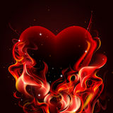 Burning heart. Burning heart on dark background Stock Image