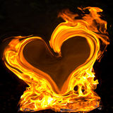 Burning heart. Big yellow flames in the shape of a heart on black background Royalty Free Stock Photo