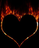 Burning heart. Burning fiery contour of heart on a black background Royalty Free Stock Image