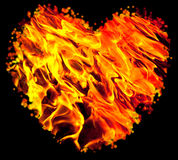 Burning heart. On black background Stock Image