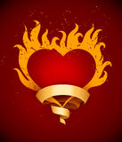 Burning heart with fire flames and ribbon Stock Photos