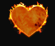 Burning heart 1. Heart on fire isolated in a black background Royalty Free Stock Photos