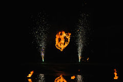 Burning heart with fireworks Stock Photo